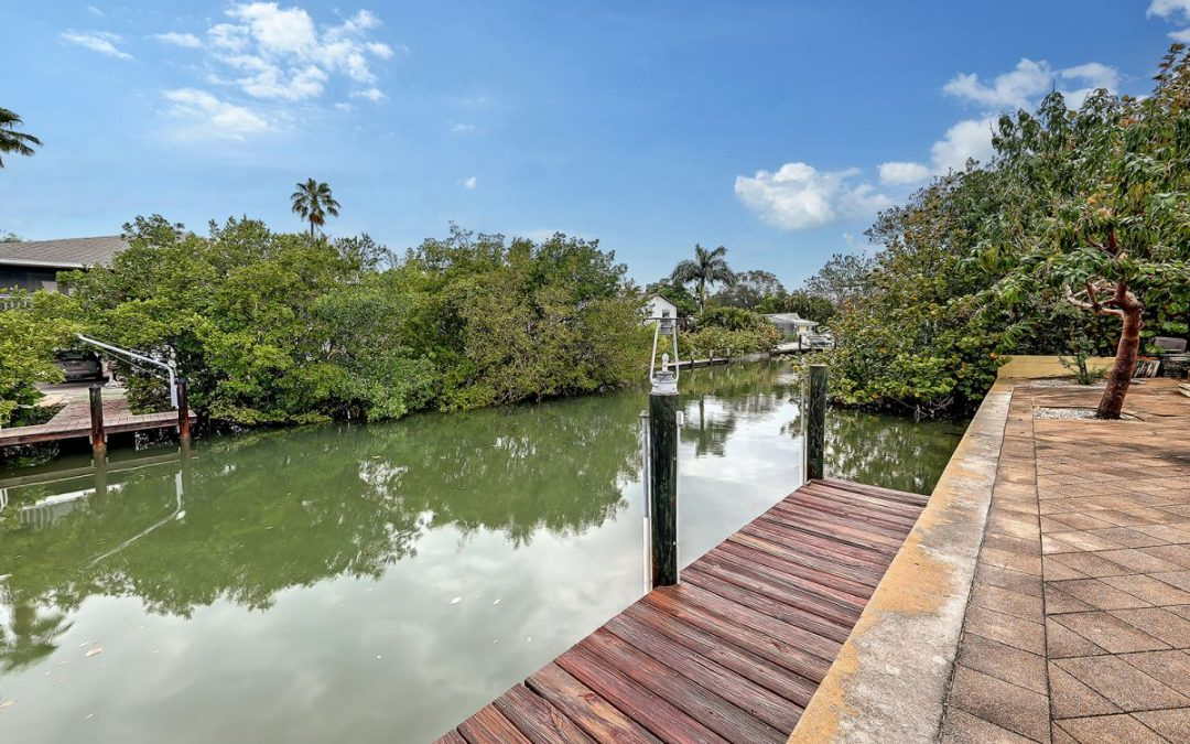 JUST LISTED! Lowest Price Canal Home on Longboat Key for $765,000