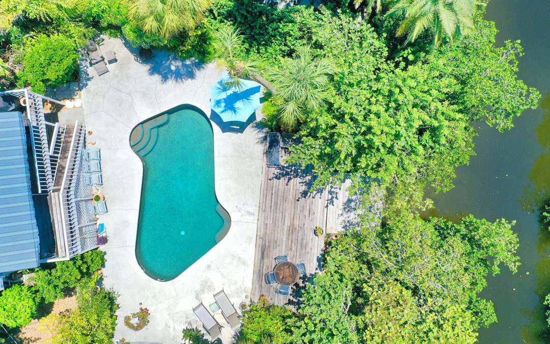 Diamond in the Rough; Charming Siesta Key Canal Front Home